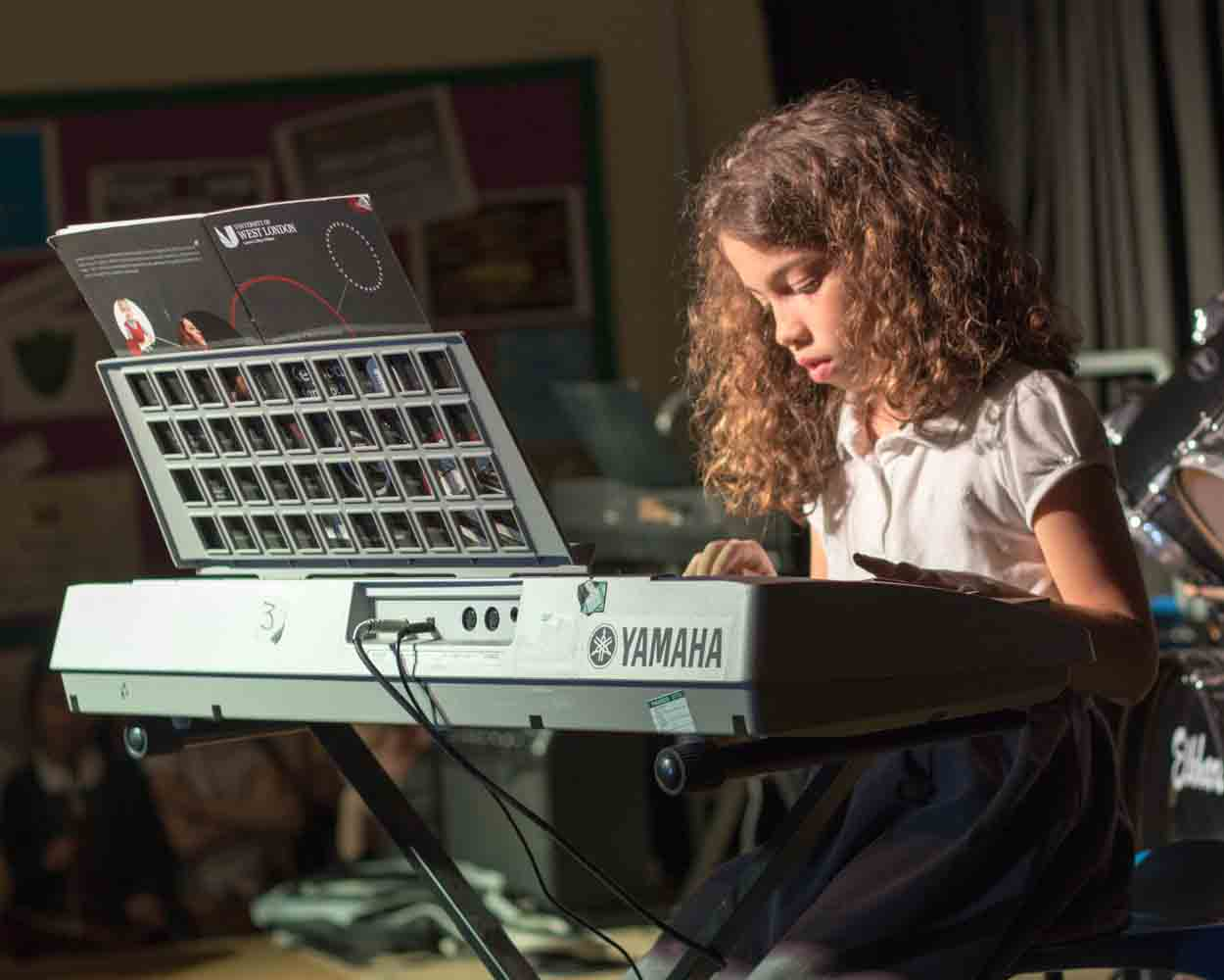Child playing a keyboard